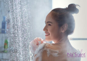 Asian woman Enjoying the shower and rubbing soap She feels relaxed