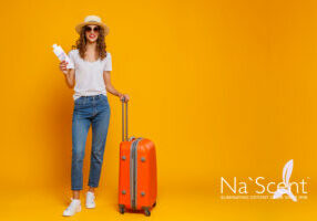 concept of travel. happy woman girl with suitcase and  passport on  yellow background